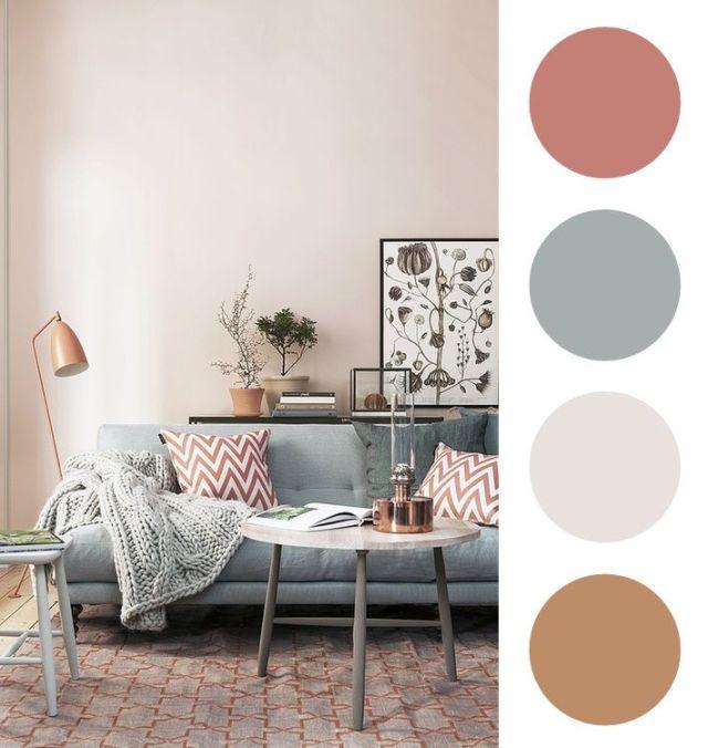 Por mais que essa sala tenha tons de bege e cinza, esse tom de marrom avermelhado nas almofadas e nos outros objetos, traz um toque de cor mas mantém a sobriedade da decoração.